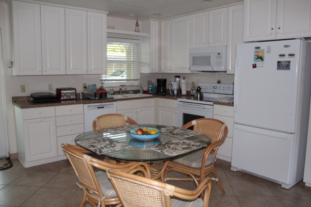 Spacious kitchen with seating for four.