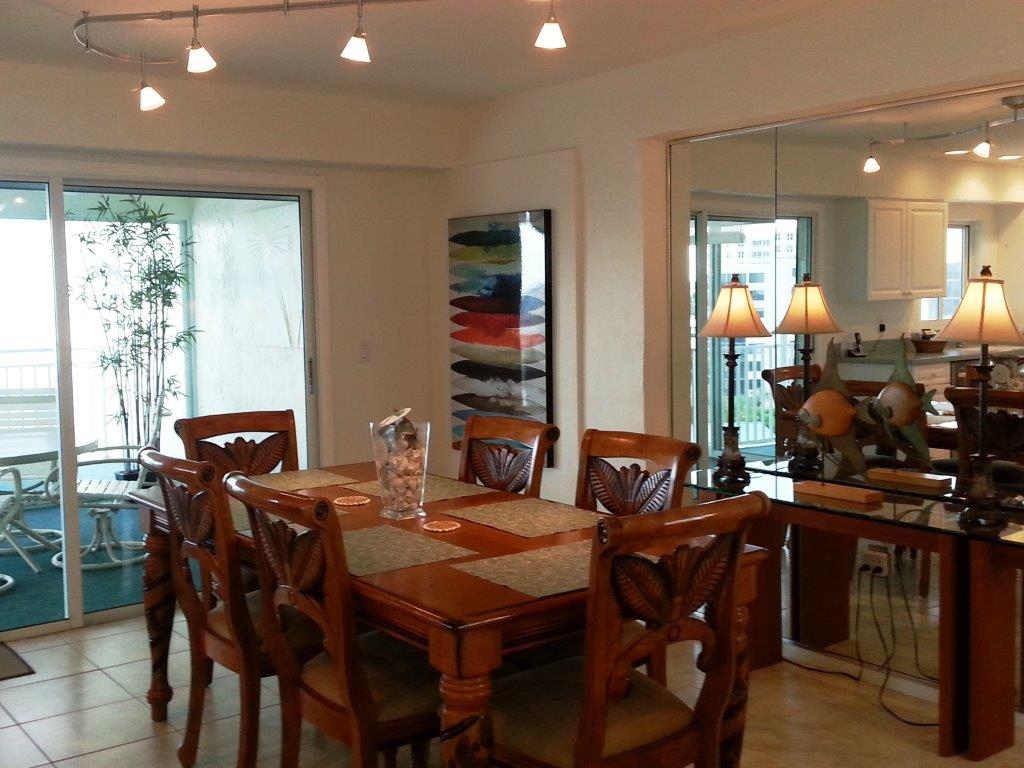 The dining area sits just off the balcony.