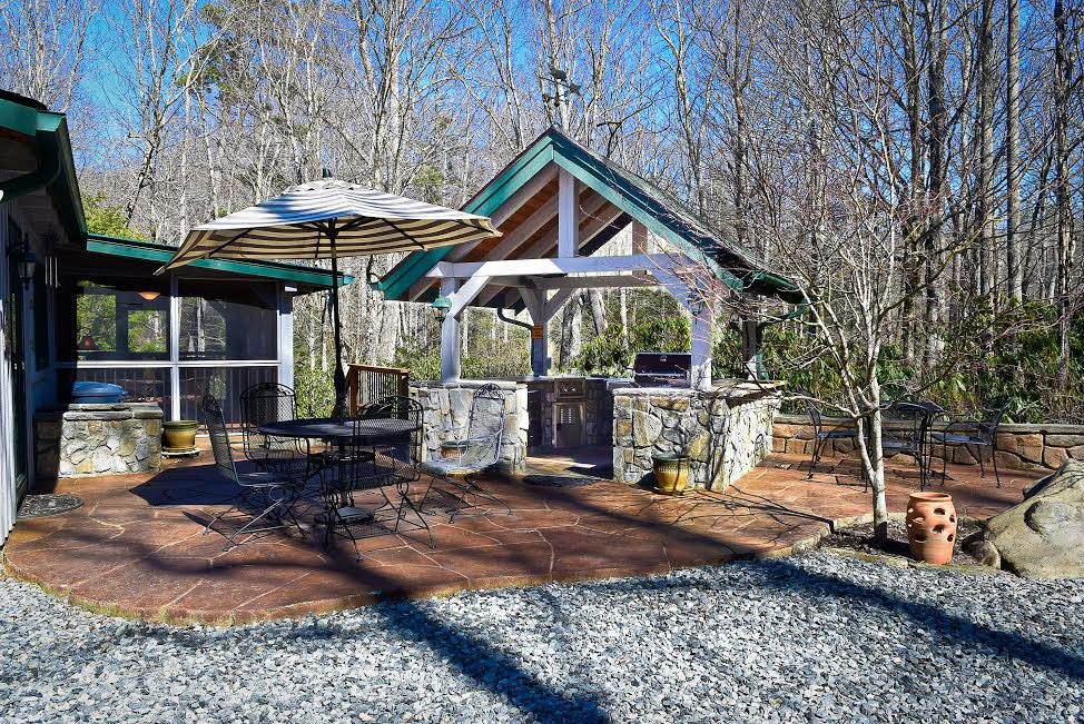 The home has a covered outdoor kitchen with a Weber gas grill for those steaks or BBQ dinners.