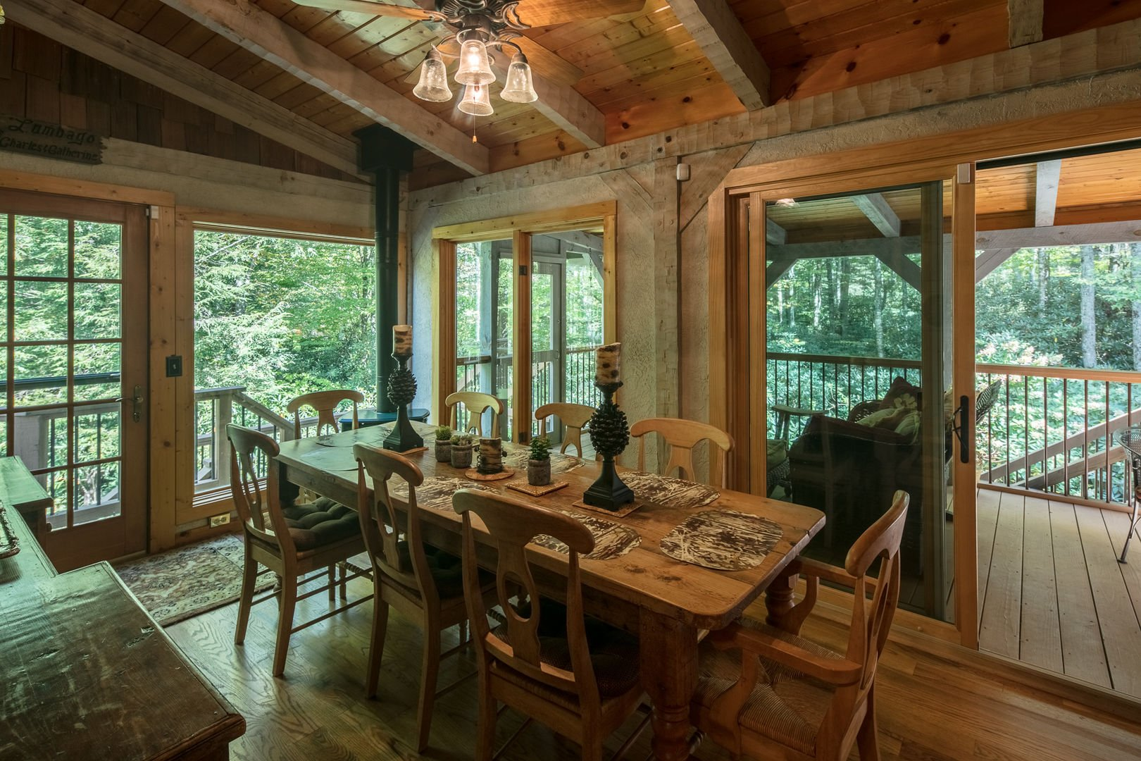 Dining indoors with a view of the forest at Almost Perfect in Blowing Rock, NC.