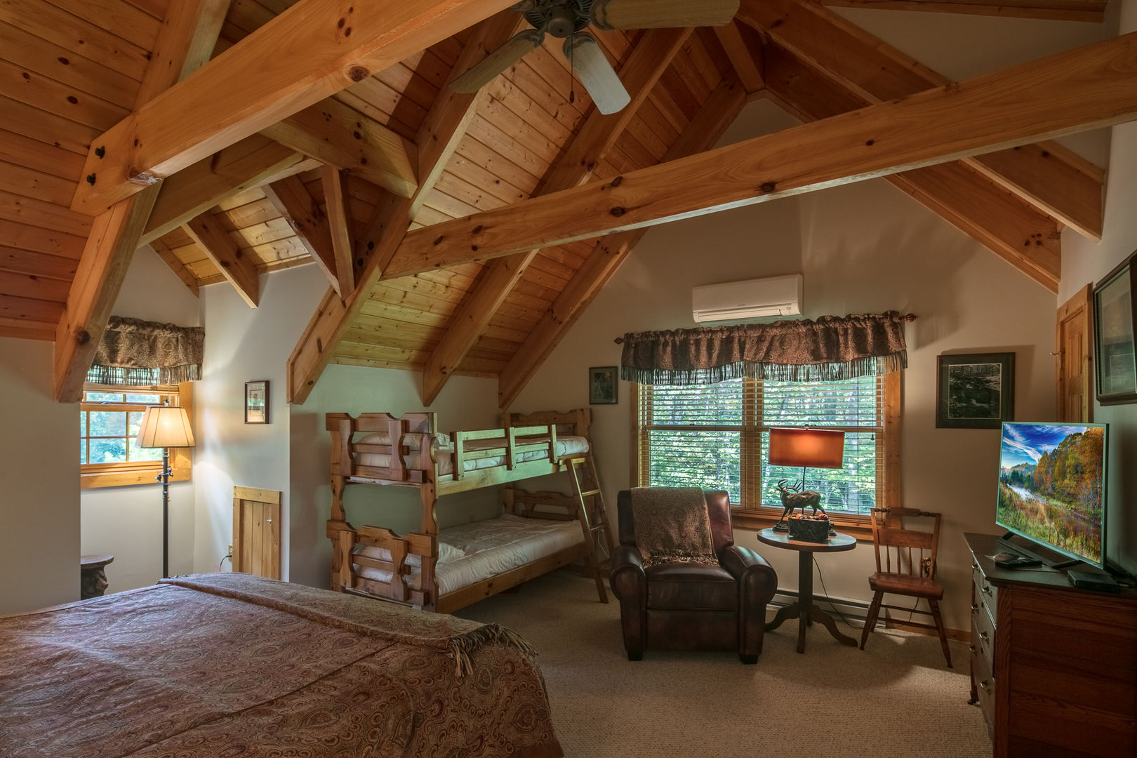 This large bedroom is perfect for a family with young children or a group of teens.