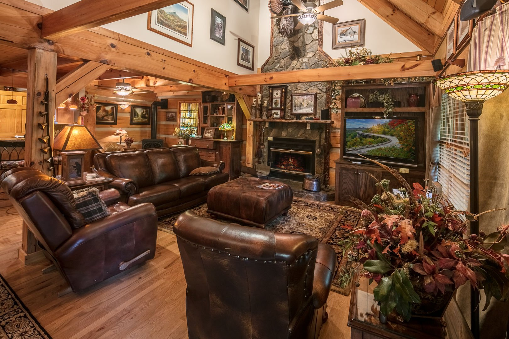 The living room has leather furniture and a cozy fireplace.  Almost Perfect in Blowing Rock, NC. #fireplace