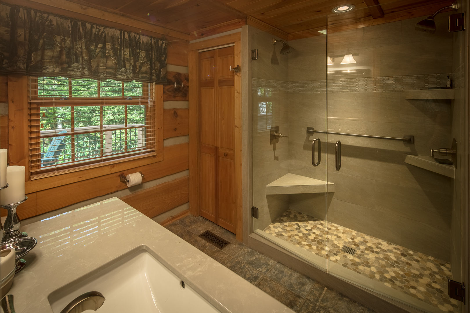 The master bath includes an amazing step in shower with pebbled floor.