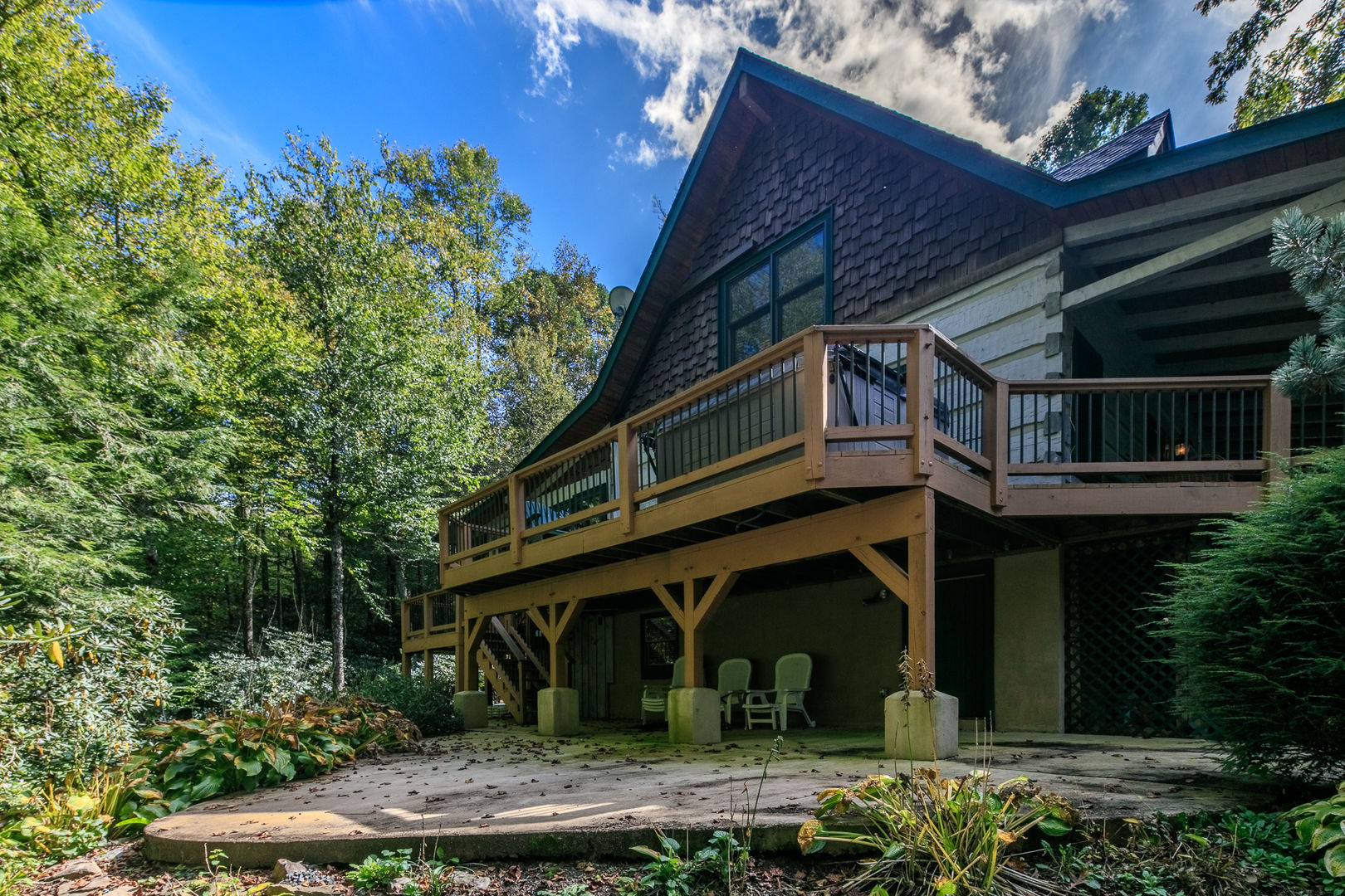 The porch wraps around the home. Almost Perfect in Blowing Rock, NC.