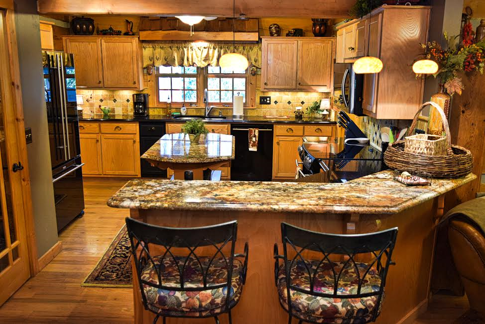 View of the dining counter and kitchen of Almost Perfect.