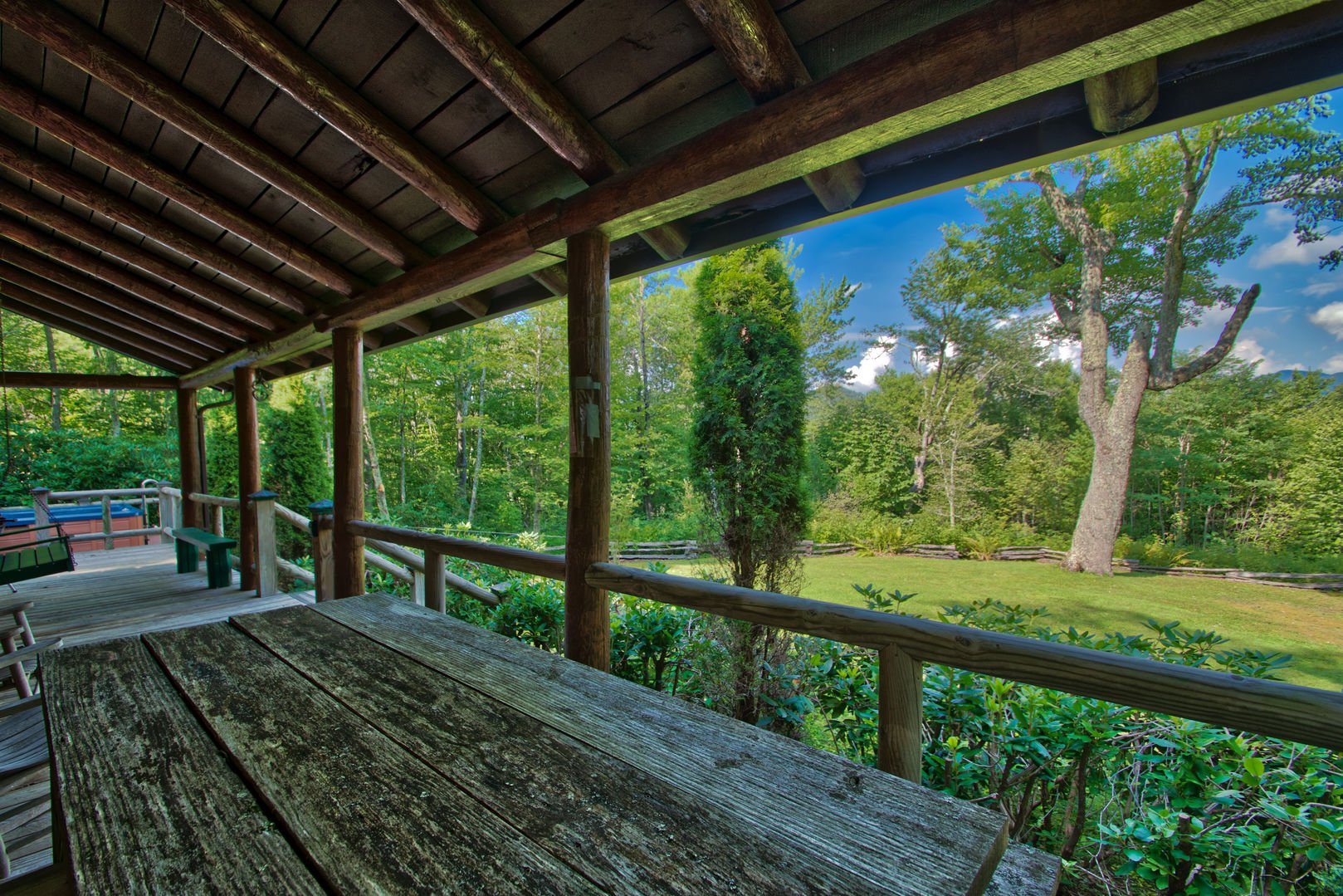 Front porch views of the woods and mountains