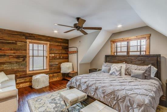 Upper level bedroom with king bed and full bath