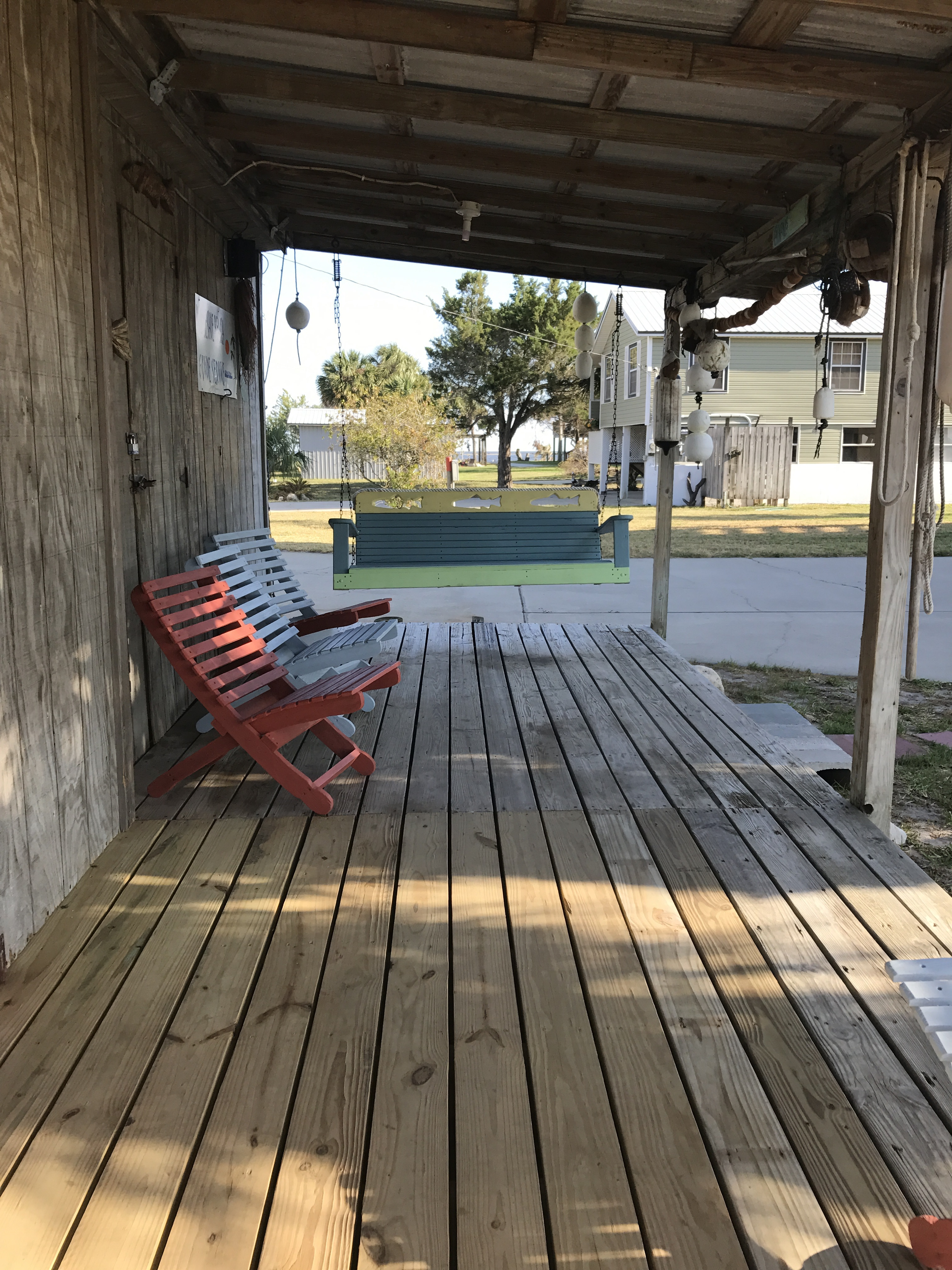 Porch with swing and seatin at Fish Cleaning Shed