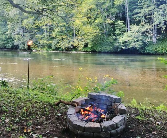 Relax by the river and enjoy the fire pit