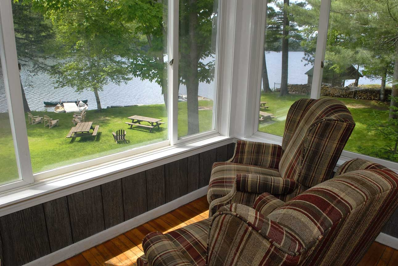 The Maine House: Porch overlooking Bryant Pond