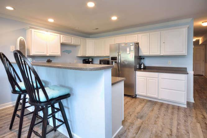 105 SE 58th St Oak Island NC-small-009-17-KitchenBreakfast Bar-666x444-72dpi