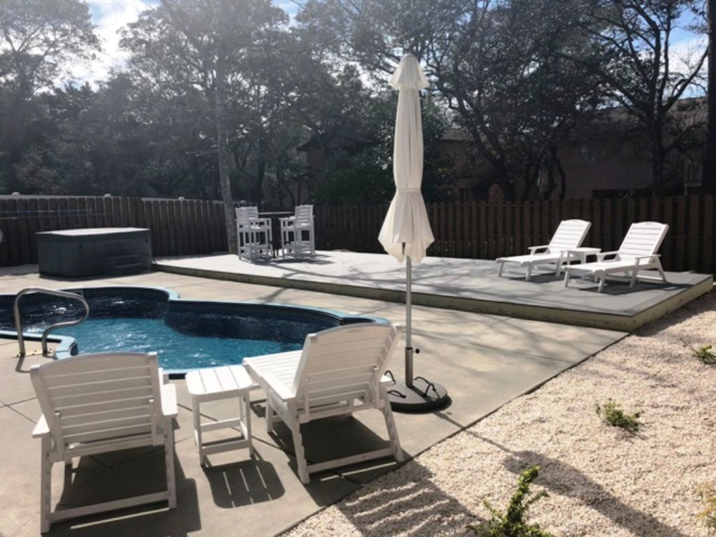 Pool and deck with hot tub