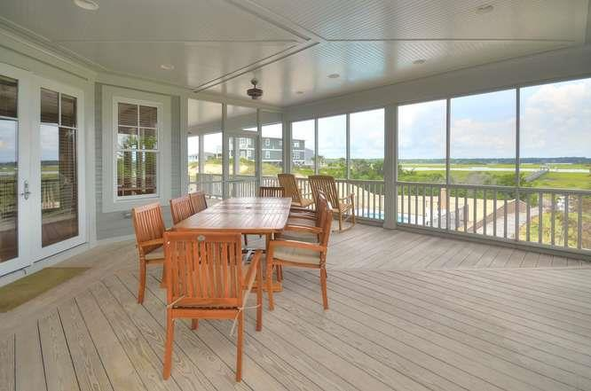 6622 Kings Lynn Dr Oak Island-small-009-48-Screened Dining Porch-666x441-72dpi