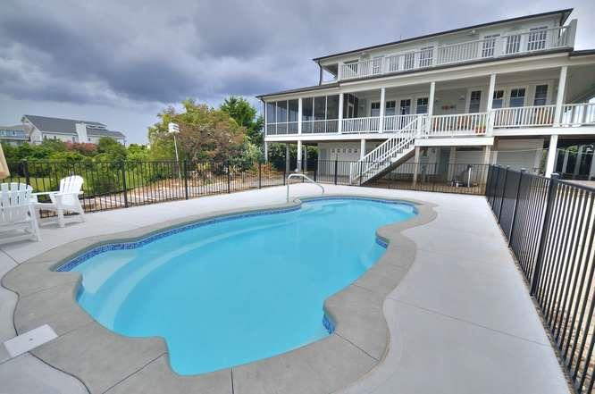 6622 Kings Lynn Dr Oak Island-small-052-3-PoolBack of Home-666x442-72dpi