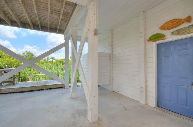 326 E Dolphin Dr Oak Island NC-small-036-41-Outdoor ShowerFish Cleaning-666x441-72dpi