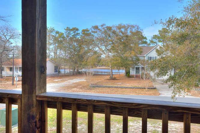 1007 W Yacht Dr Waters Edge-small-024-31-Front Porch Waterway View-666x444-72dpi