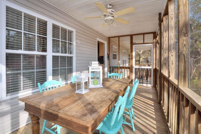 1007 W Yacht Dr Waters Edge-small-027-30-Screened Dining Porch-666x444-72dpi