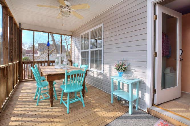 1007 W Yacht Dr Waters Edge-small-028-29-Screened Dining Porch-666x444-72dpi