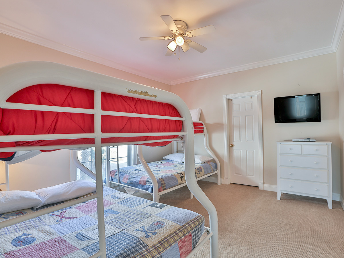 Bunk Beds with TV and White  dress.   Small Twin bed in the photo as well - Seaspray9