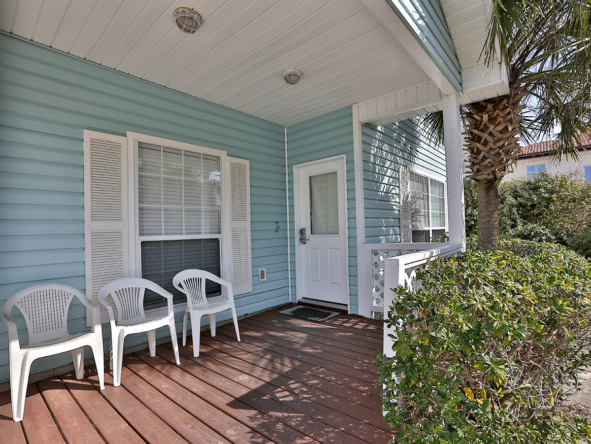 Rear view of patio of beach vacation rental home - Chairs and window