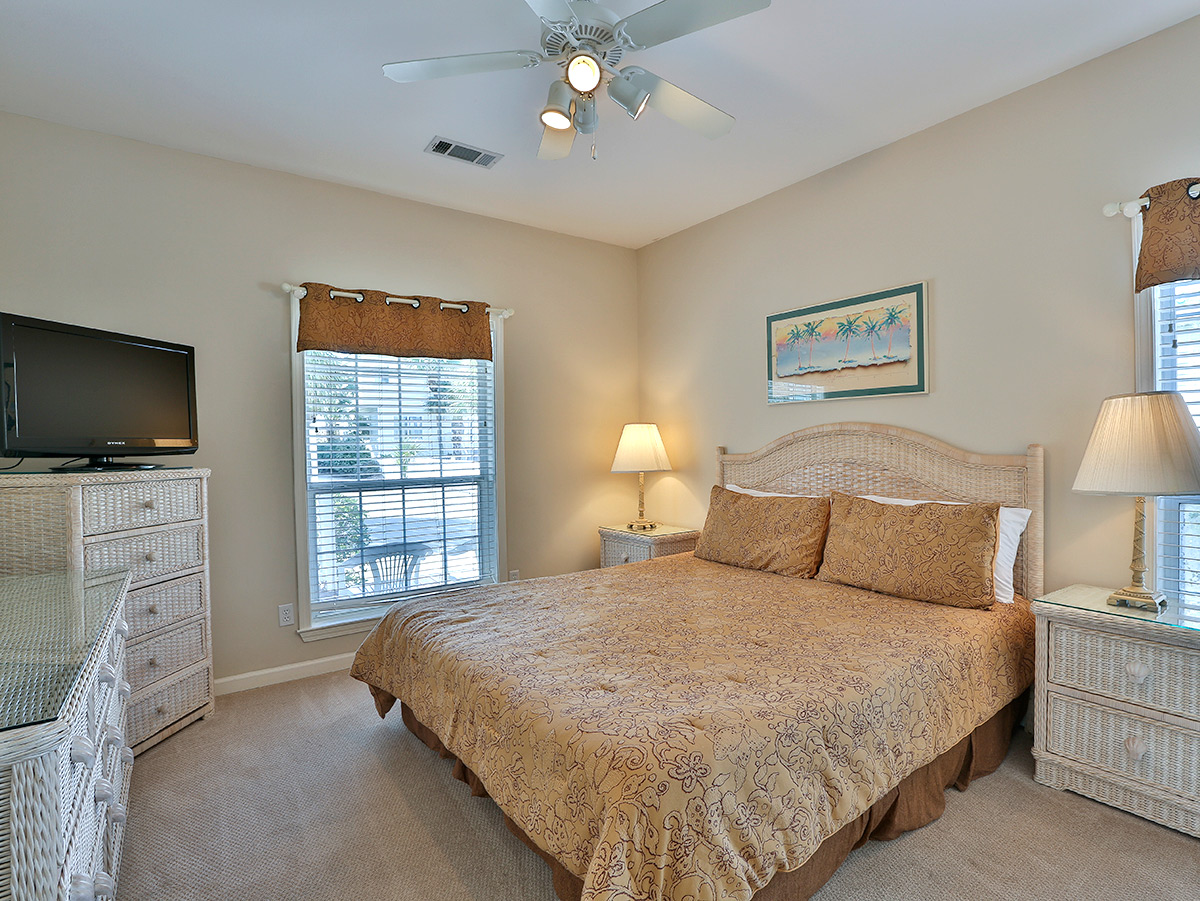 Bedroom - Queen size bed with picture over the bed - Two windows in the room Seaspray beach fl
