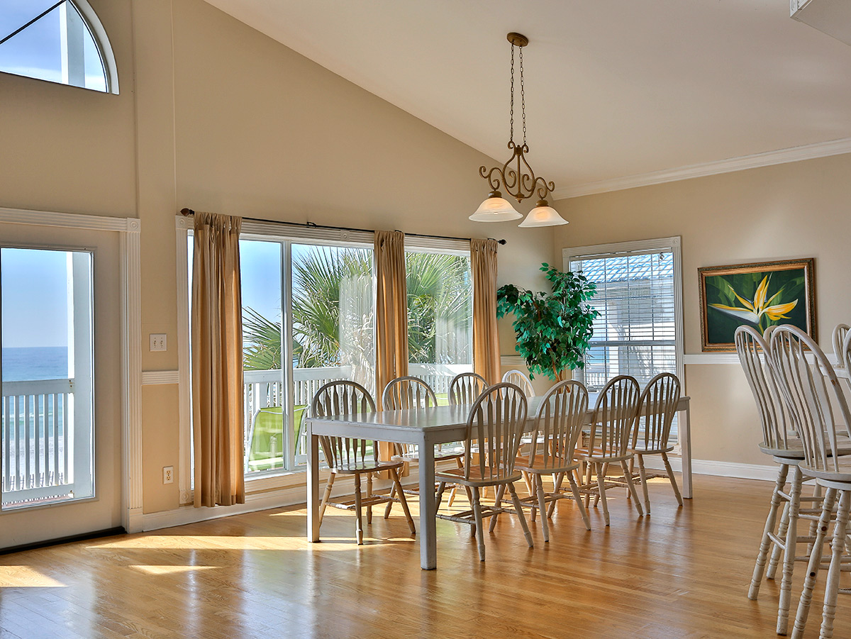 Dinning room view looking out into the ocean.  Vaulted ceilings