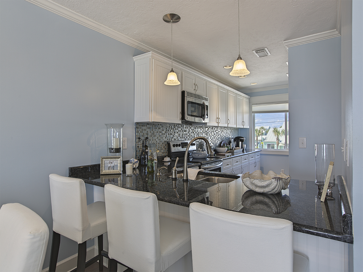 Photos of the kitchen from the dinning room -  Kitchen has nice white cabinets