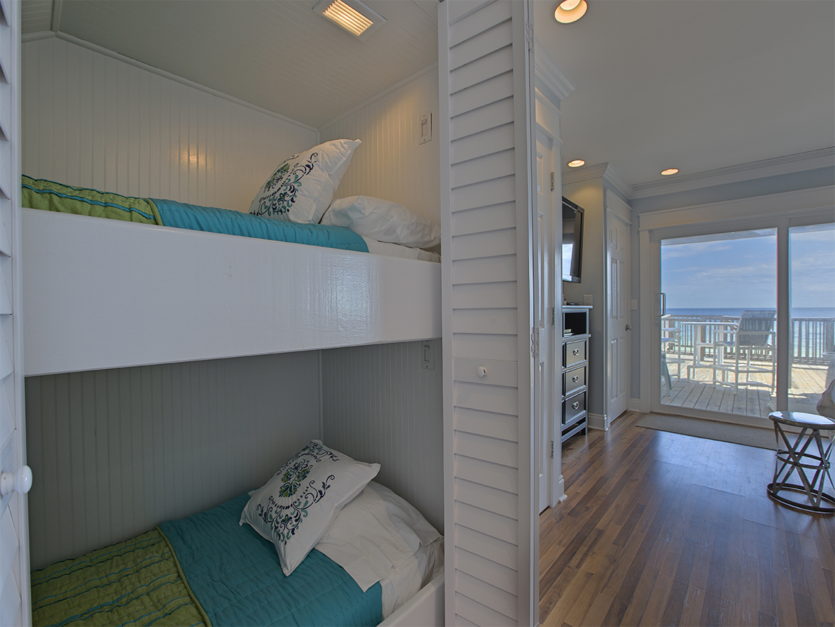 Bedroom with two bunk beds  - Hard wood floors  - Beach view