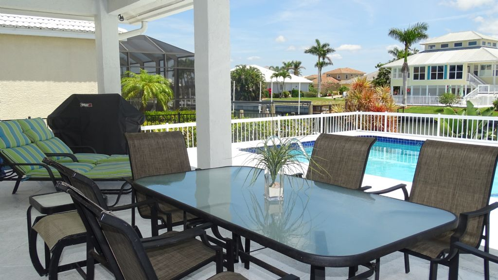 Outside Dining area Marco Island 3 bedroom waterfront vacation rental