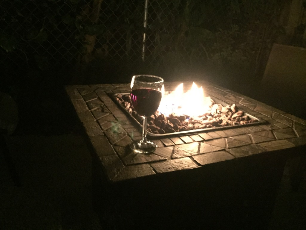 Enjoy a glass of wine by the propane fire pit!