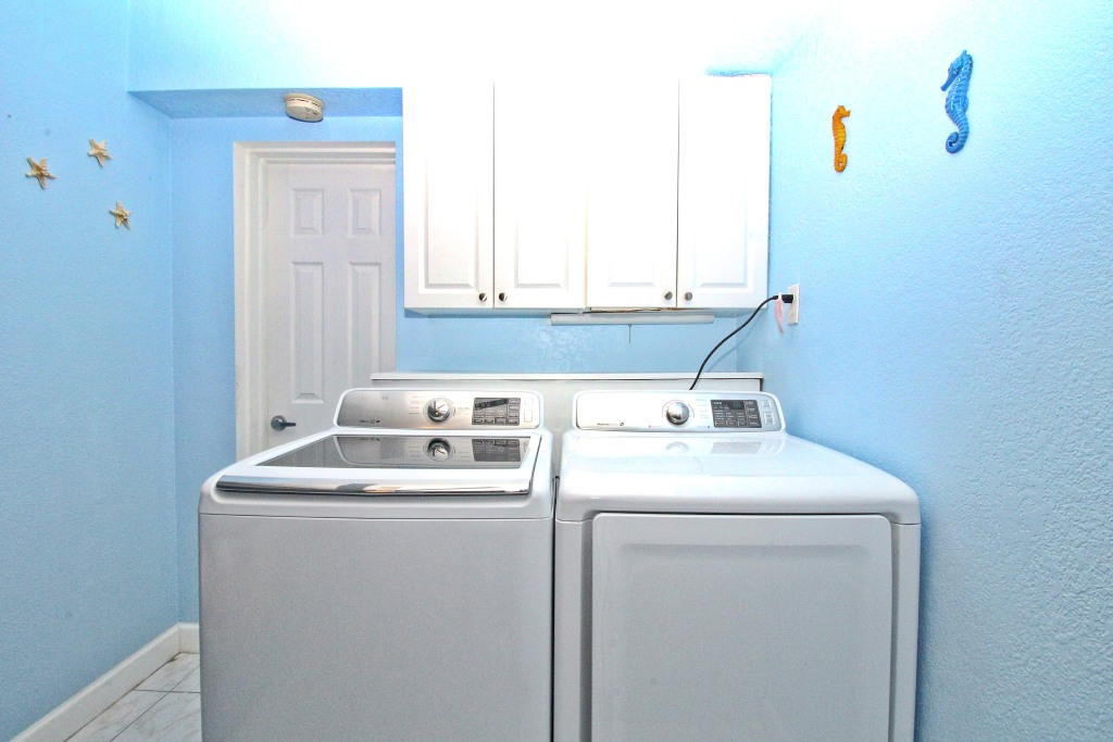 Washer dryer in guest bedroom