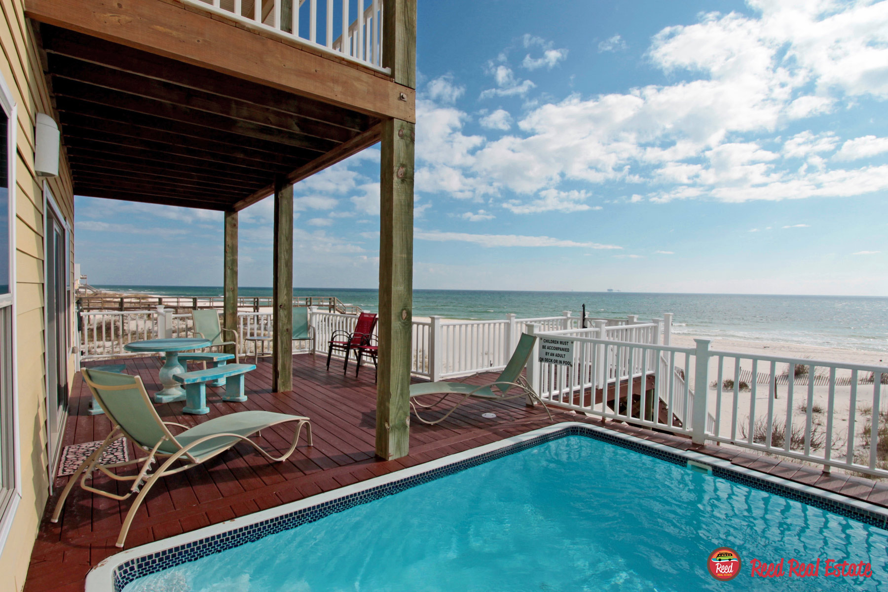 Large partially covered deck with pool