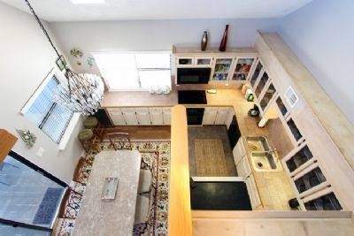 View of kitchen/dining area from loft