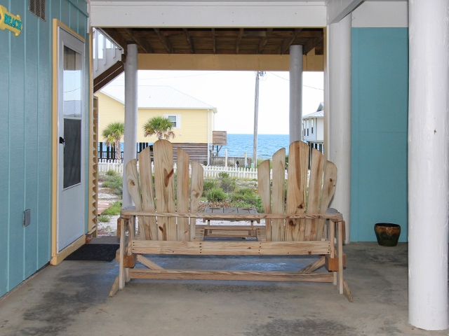 Relax under the house and watch the waves