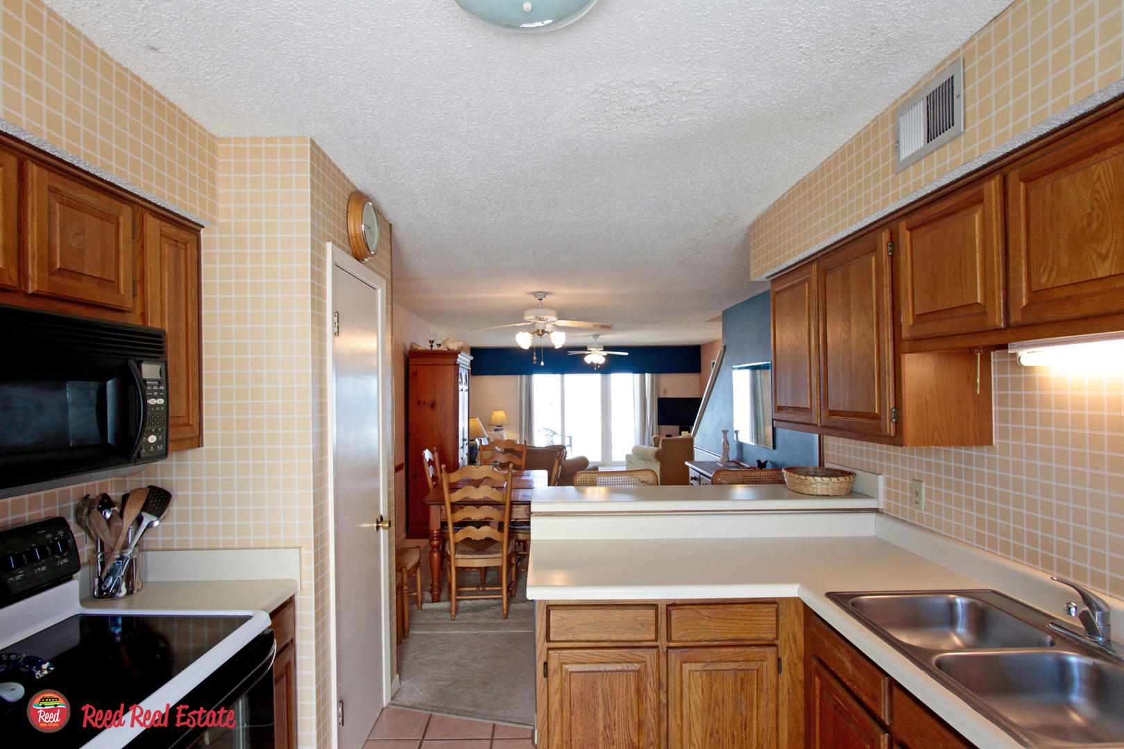 Kitchen overlooking living/dining area
