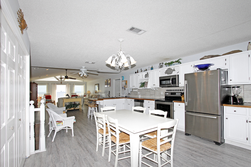 Open floor plan flows from living room to kitchen