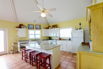 Kitchen area with eat-in island