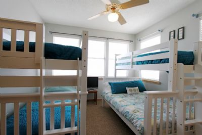 bunk room with 3 twins and a double