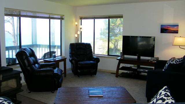 Seating and TV, woodstove, plus dramatic views.