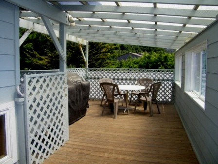 BBQ deck off living room, sheltered with great views!