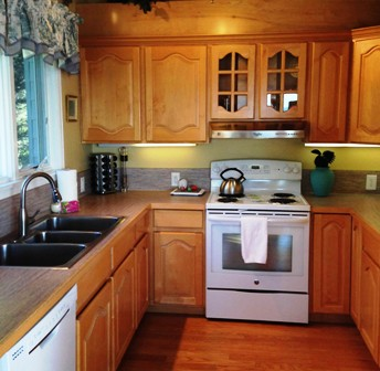 A full well equipped kitchen with great lighting