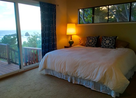 Guest room with door onto deck and open to the ocean sounds.