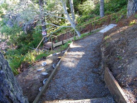 Sloping portion of path leads to more steps down to beach.