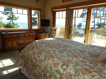 Masterbedroom has views of the ocean, and access to the deck